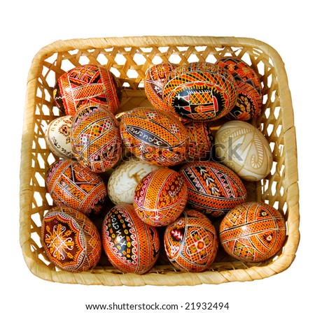 "Ukrainian Easter Eggs - ""pysanky""  in a basket isolated on a white background"
