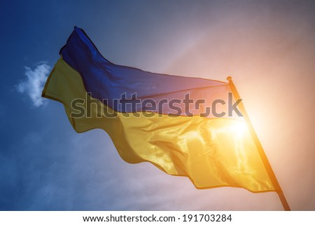 ukrainian flag on sky background - stock photo