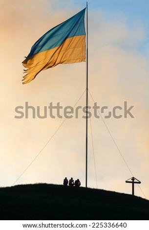 Ukrainian flag on top of hill - stock photo