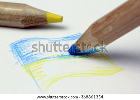Ukrainian flag painted yellow pencil on paper