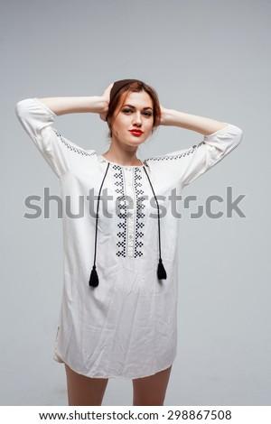 Ukrainian girl hipster wear ethnic dress at studio    - stock photo
