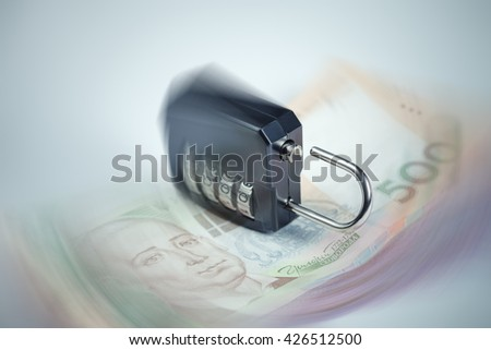 Ukrainian hryvnia fall concept. Ulocked lock as a sign of the beginning of financial chaos - stock photo