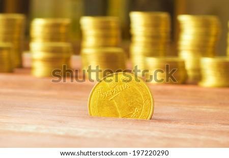 Ukrainian hryvnias, heap of coins.Ukrainian steel coin denominations of 1 hryvnia - stock photo