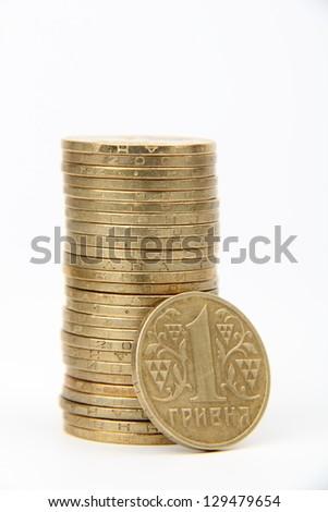 Ukrainian hryvnias, heap of coins/Ukrainian steel coin denominations of 1 hryvnia on a white background - stock photo
