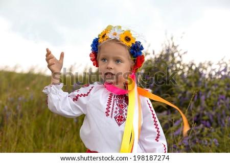 Ukrainian little girl and yellow field - stock photo