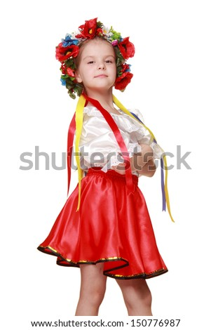 Ukrainian little girl with a beautiful smile dancing on a white background on Beauty and Fashion