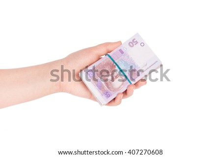 Ukrainian money fanned out in her hand isolated on white background