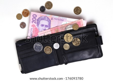 Ukrainian money in a black purse on a white background - stock photo