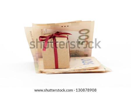 Ukrainian national currency five hundred hryvnia and a small gift