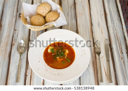 Ukrainian or Russian borscht with bread on wooden table