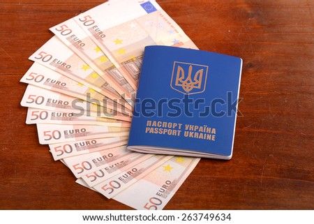 ukrainian passport with fifty and one hundred euro banknotes - stock photo