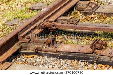 Ukrainian railways. Old railroad tracks. The period of economic crisis, there is no cargo. Not serviced joints are covered with rust. Railway junction. - stock photo