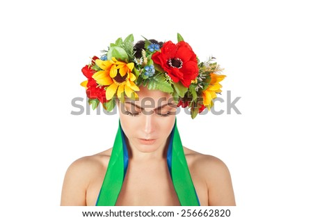 Ukrainian sad girl in a wreath
