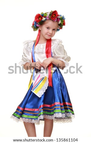 Ukrainian small girl in bright traditional dress on Beauty and Fashion