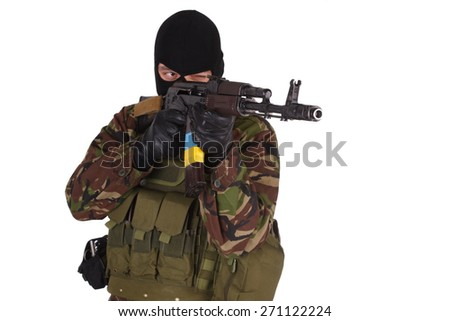 Ukrainian volunteer with kalashnikov rifle isolated on white
