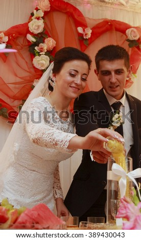 Ukrainian wedding tradition - bride and groom poured in a glass vase variety of cereals