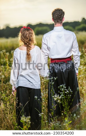 Ukrainian yang couple in traditional dreses.Slav people.