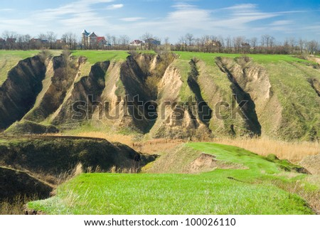 Ukranian landscape with soil erosion in early spring season. - stock photo