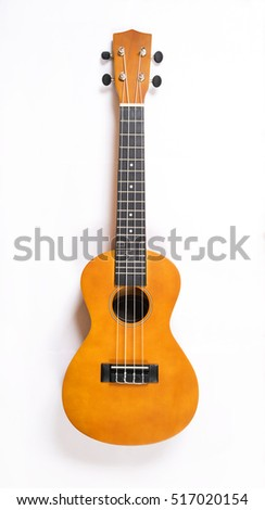 Ukulele close up in white background. Music concept.