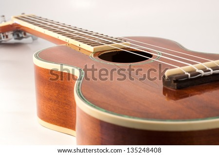 Ukulele guitar brown color on white background - stock photo