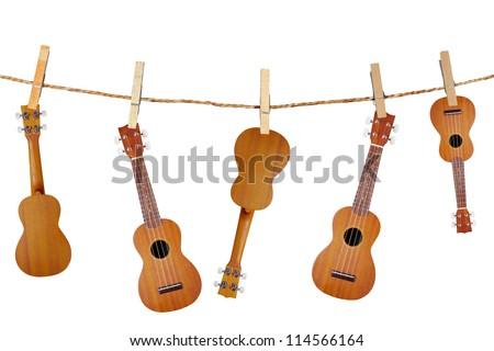 ukulele guitar family from Hawaiian in Wood clamps - stock photo