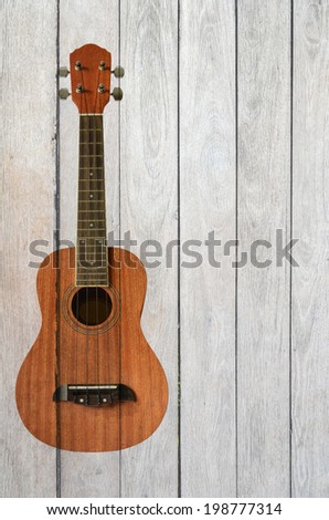 ukulele guitar on wood background