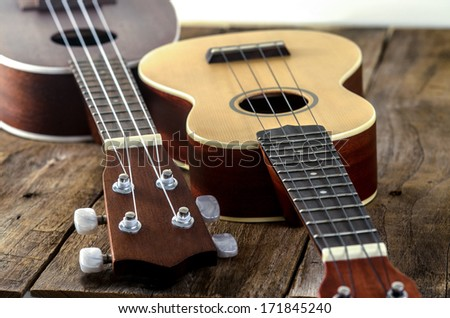 ukuleles  on  wooden background.