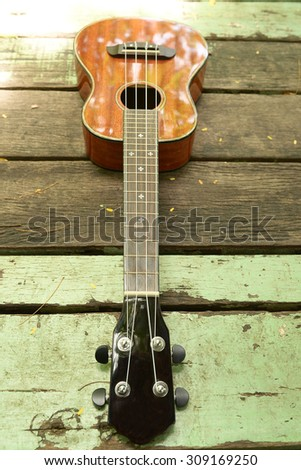 ukuleles on wooden background
