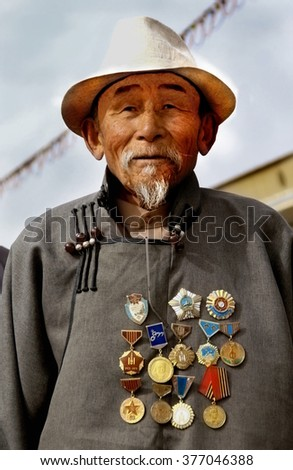 ULAAN BATAAR , MONGOLIA - 28-04-2008 ; Mongolian man with traditional clothing is proud showing  many decorations and medals on his chest  - stock photo