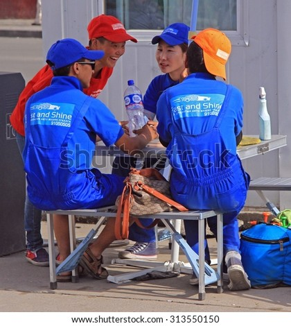 ULAANBAATAR, MONGOLIA - JULY 8, 2015: workers of service center are enjoying of break in work on the street in Ulaanbaatar, Mongolia - stock photo