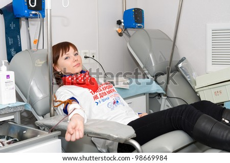 ULAN-UDE, RUSSIA - APRIL 7: The City Blood Service makes a promo action for donorship popularization. An unidentified volunteer of the service donates blood, April 7, 2010, Ulan-Ude, Buryatia, Russia. - stock photo