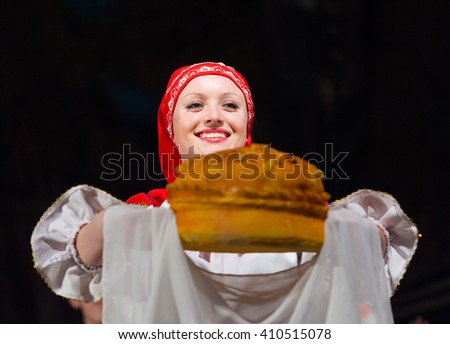 ULAN-UDE, RUSSIA - FEBRUARY 10, 2010: A woman dancer holds bread and salt at the Annual Republican Best Sportsmen Award. Bread and salt is a welcome greeting ceremony in the Russian culture. - stock photo