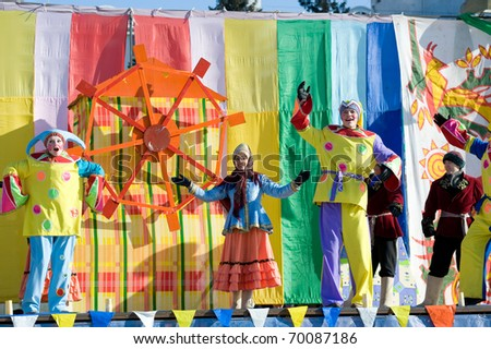 ULAN-UDE, RUSSIA - FEBRUARY 14: Actors in Russian folk costumes perform a cheerful show on the last day of the Pancake festival, February, 14, 2010, Ulan-Ude, Russia.