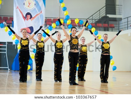 ULAN-UDE, RUSSIA - MAY 2: The Festival of aerobics and fitness, May 2, 2010 in Ulan-Ude, Buryatia, Russia. Unidentified girls in black and gold suits end their number.
