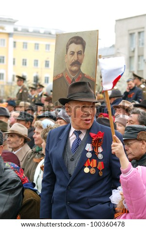 ULAN-UDE, RUSSIA - MAY 9: Unidentified Russian veterans of World War II watch the parade on annual Victory Day, May  9, 2007 in Ulan-Ude, Buryatia, Russia.