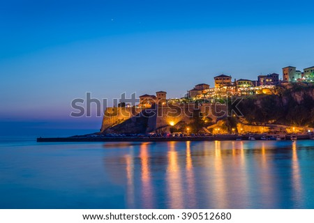Ulcinj old town fortress night long exposure photo with silky water and stars on a blue sky. Popular touristic spot in Montenegro.