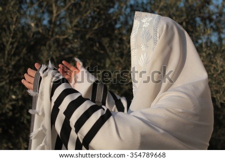 Ultra Orthodox Jewish man praying in the forest in the morning. Jewish men pray morning prayer called Shacharis every day as observed   - stock photo
