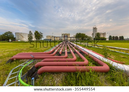 Ultra wide angle view of colored pipes on an industrial site - stock photo