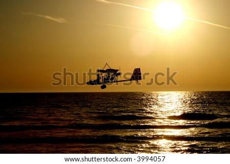 Ultralight above sea - stock photo