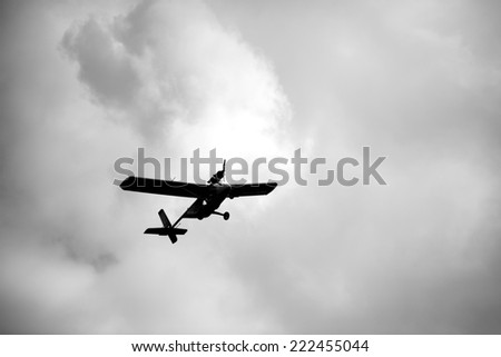 Ultralight weight airplane flying in the sky - stock photo