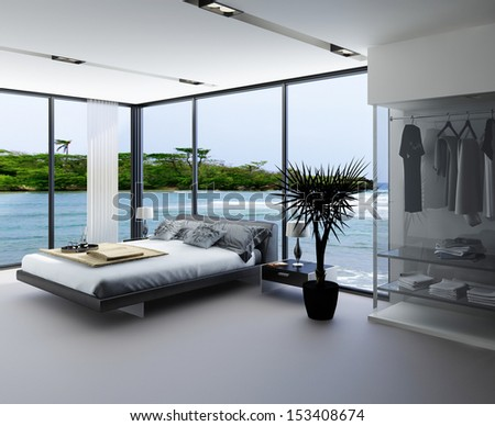 Ultramodern bedroom interior with grey bed against panorama windows with seascape view - stock photo