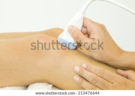 Ultrasound echo on the knee of a woman - stock photo