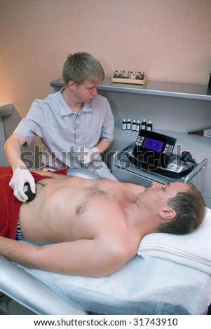 ultrasound investigation - stock photo