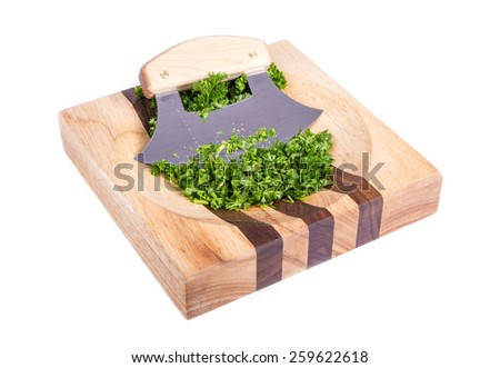 Ulu and Chopped Parsley Sitting on a Wooden Block Isolated on White - stock photo