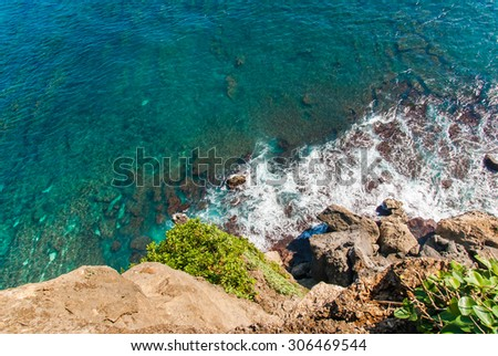 Ulu Watu coastline with beautiful rocky cliffs and wavey sea. - stock photo