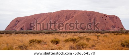 Uluru - Ayers Rock. Aboriginal sacred place. UNESO world heritage. Sunrise sun is color painting red sandstone rock. PR available - image approved for commercial use by Park authorities.