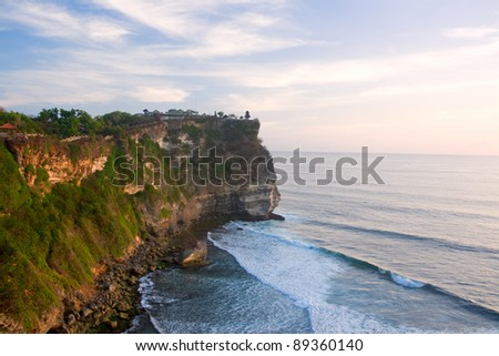 Uluwatu Temple in Bali on the rock. - stock photo