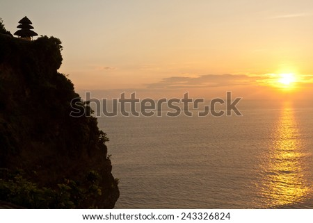 Uluwatu temple on sunset (Bali, Indonesia) - stock photo