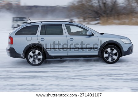 Ulyanovsk, Russia - January 09, 2015: Auto racing on ice. Car driving on a snowy and iced road.