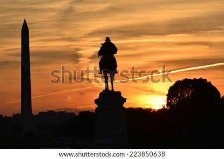 Ulysses S. Grant Memorial and Washington Monument silhouettes in sunset - Washington DC, United States of America - stock photo